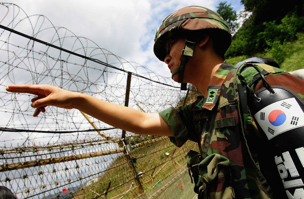 A South Korean Soldier checking the barrier, just north of Munsan.