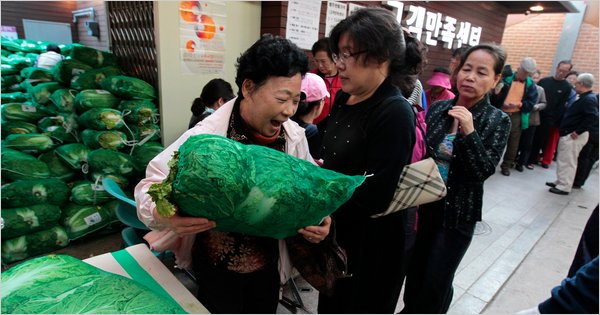 Woman queuing for hours to buy the coveted cabbage