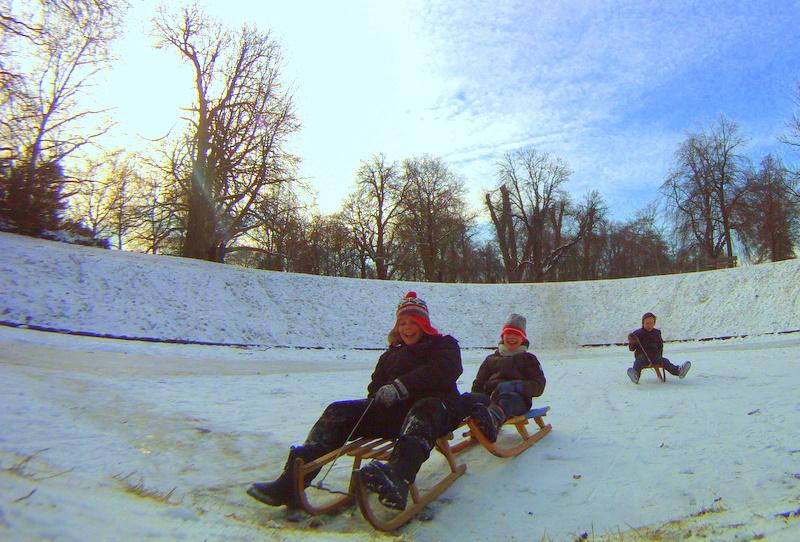Children Sledding across a Frozen Lake in Groningen