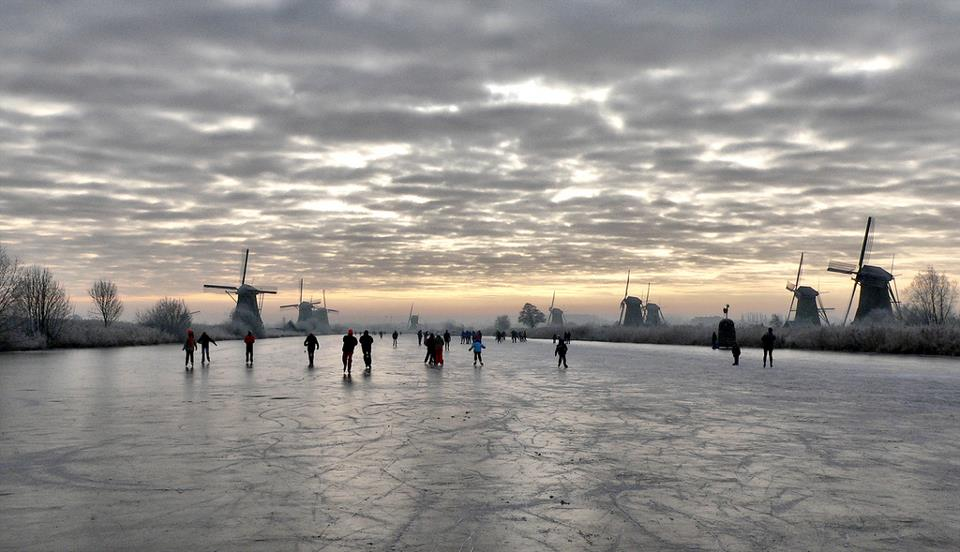 ice skating on frozen canals in the netherlands