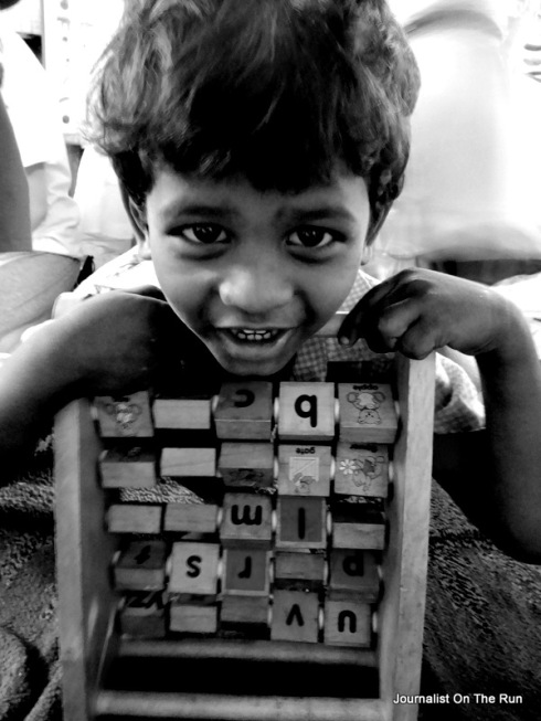 boy with alphabet abacus