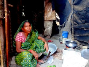 woman cooking in slum
