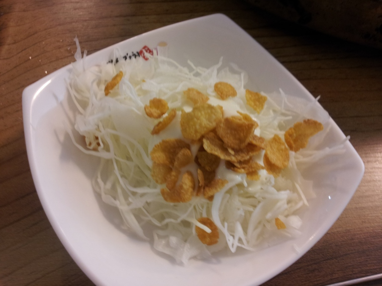 Dig into some of the more unusual side dishes such as shredded cabbage, mayo and cornflakes!