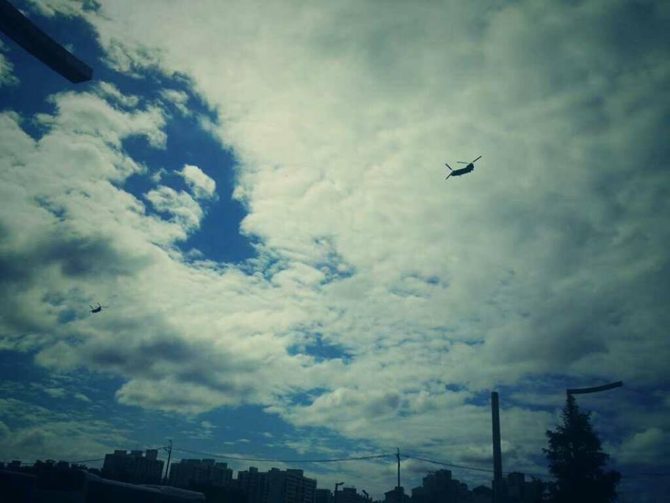 Two Black Hawk helicopters fly over my school in Munsan, South Korea.